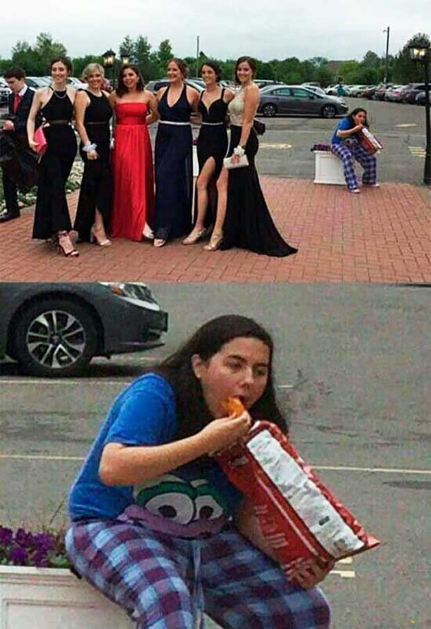 Funny pic of women posing in formal dresses, girl photobomb stuffing mouth with Doritos