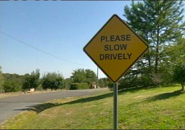 Close enough ... ... funny signs... please slow drivel street sign
