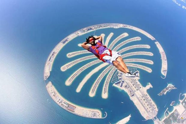 perfectly timed, kicked back skydiver playing it cool over and made islands in Dubai
