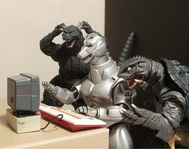 Funny pics ~Godzilla toys action figures playing video games