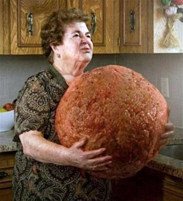 Awkward grandma in kitchen with giant meatball ~ Funny Pics & Memes