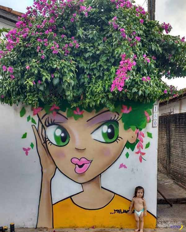 Cool wall mural ~ woman's face with real tree branches and leafs for hair