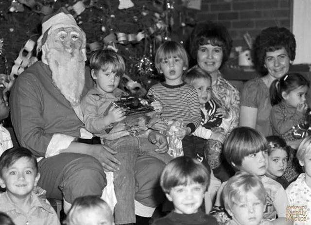 Love the kid in the lower left! ~ Vintage Funny Family Christmas Photo ~ 1960s ~ Creepy Santa