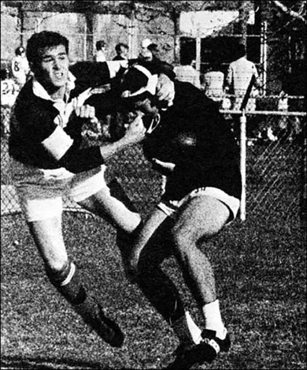 A surly future U.S. President George W. Bush playing dirty rugby for Yale in 1966.
