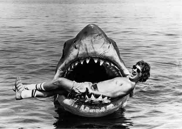 """Steven Spielberg on the set ofJawsin 1975. Here, the 27-year-old director takes a break in the jaws of the great white that was lovingly referred by the film crew as """"Bruce."""""""