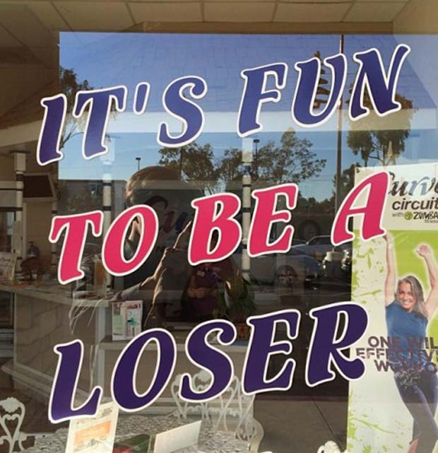 Yes it is! ... Wait... funny store sign, window, it's fun to be a loser
