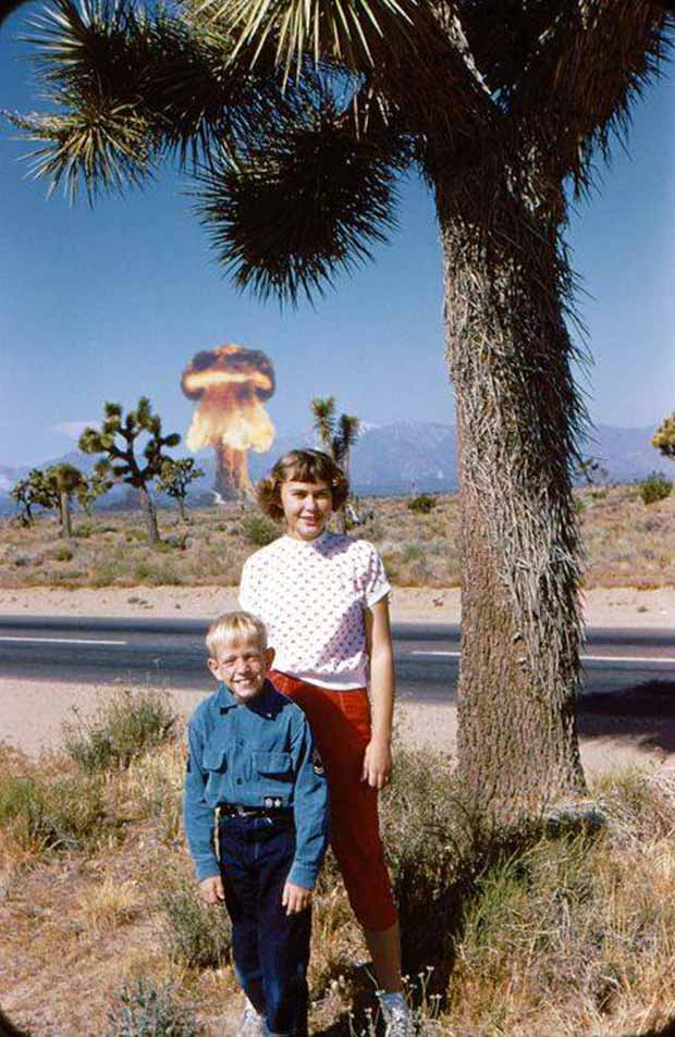 My, how quickly radiation can affect a little boy. ~.~.~ funny awkward family vintage photos 1950s 1960s mom boy posing nuclear bomb test