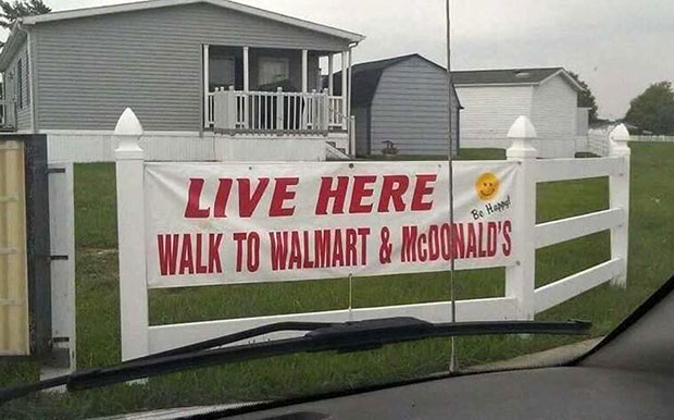 Funny Stupid Signs ~ banner outside mobile home trailer park ~ walk to Walmart and McDonald's