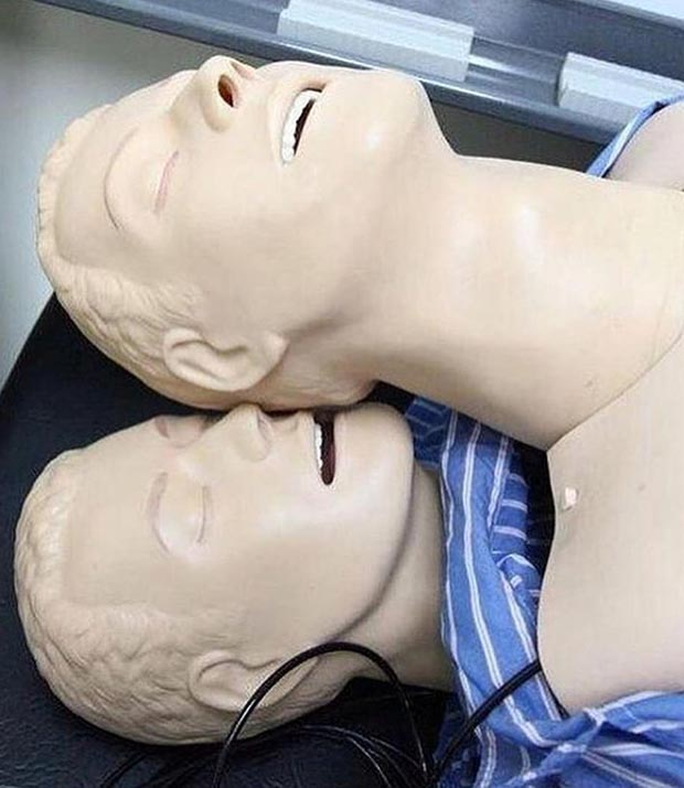 33 Funny Pics and Memes of the Day ~ sexy cpr dummies flirting, kissing ear