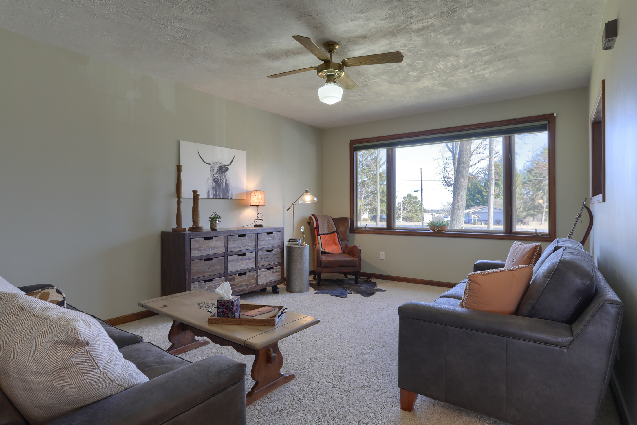 285 Strack Drive - living room with large window to enjoy quiet wooded setting