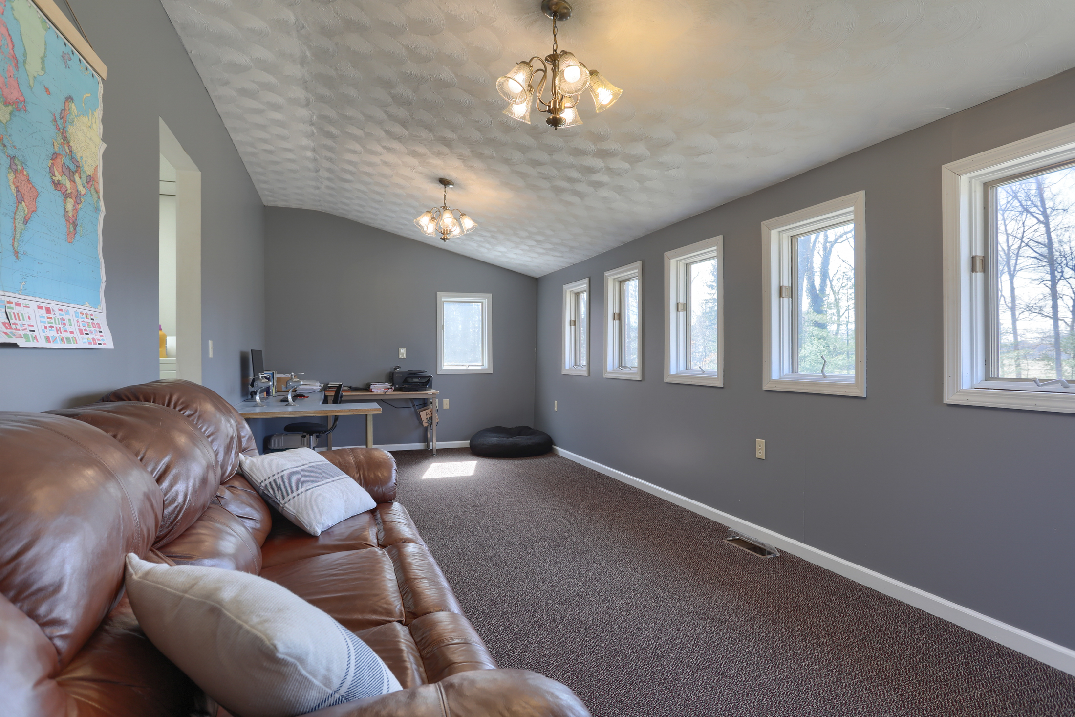 285 Strack Drive - Den with windows open to quiet wooded setting