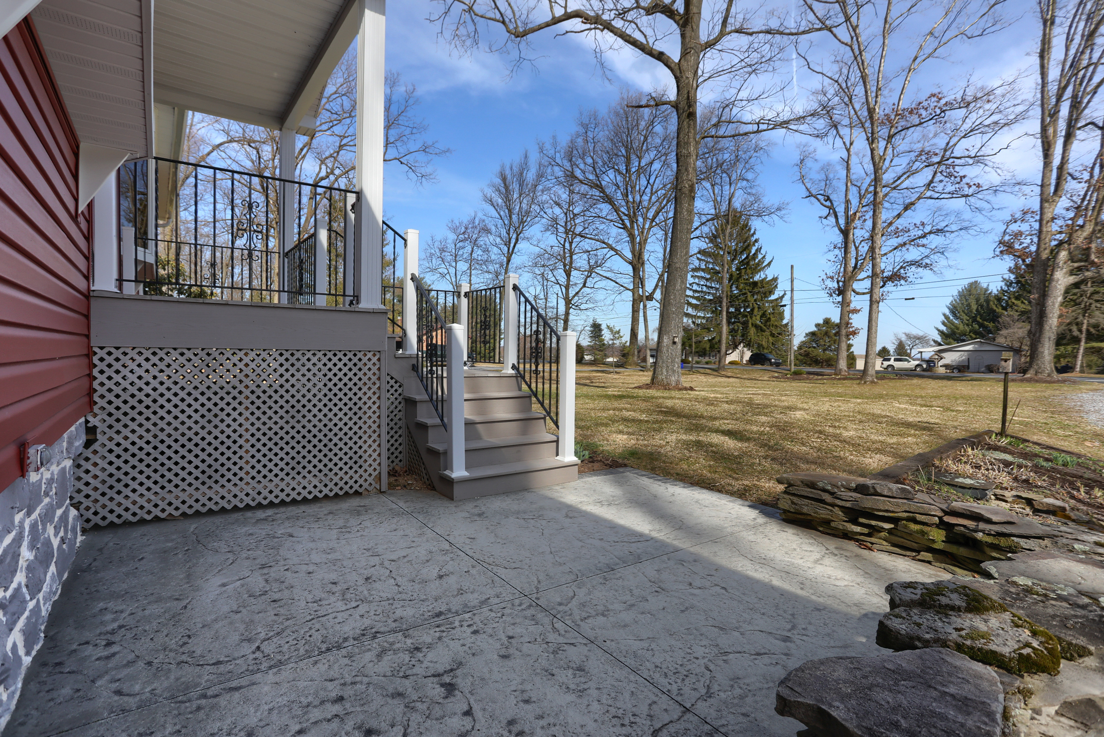 285 Strack Drive - Front patio with quiet wooded setting