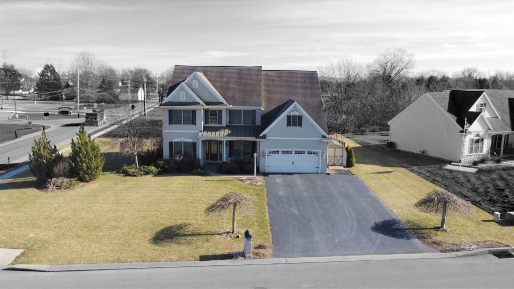 Aerial view with property lines of spacious cedar crest home