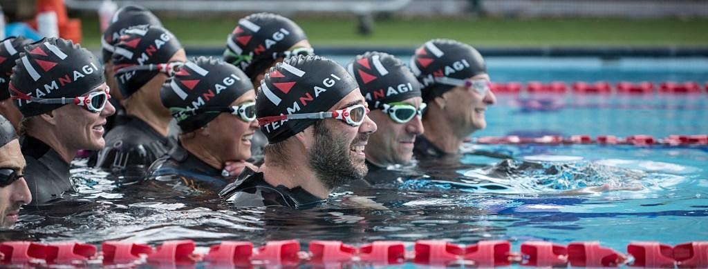 julian-nagi-triathlon-professional-training-swimsmooth-coach-ironman-athlete-swimmer-hats-team-open-water-training-photographer-teresa-walton-swim-squad