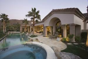 Temecula Luxury swimming pool and house exterior at dusk