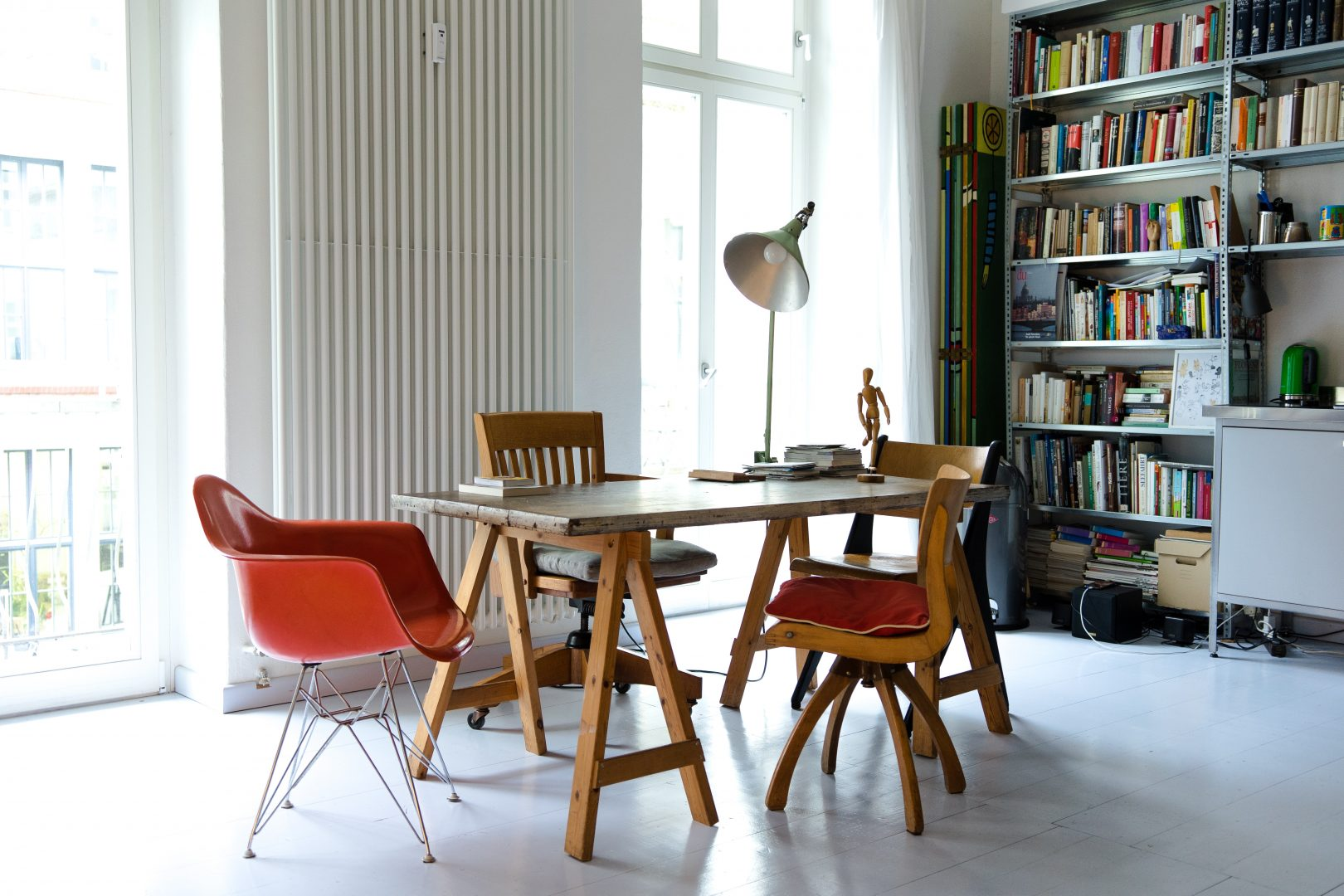 photography of brown wooden dining set near window