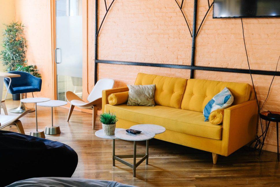 yellow sofa near wall