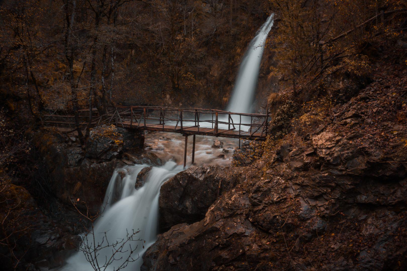 wooden bridge over flowing water