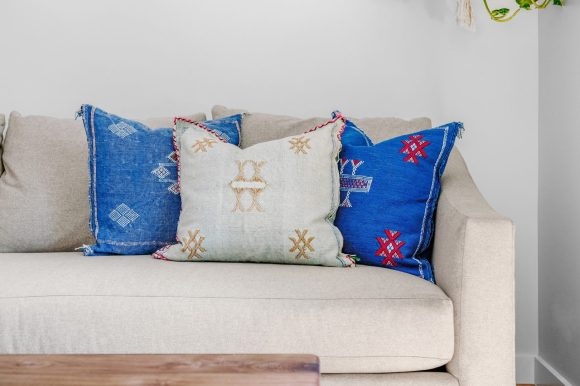 white and blue throw pillows