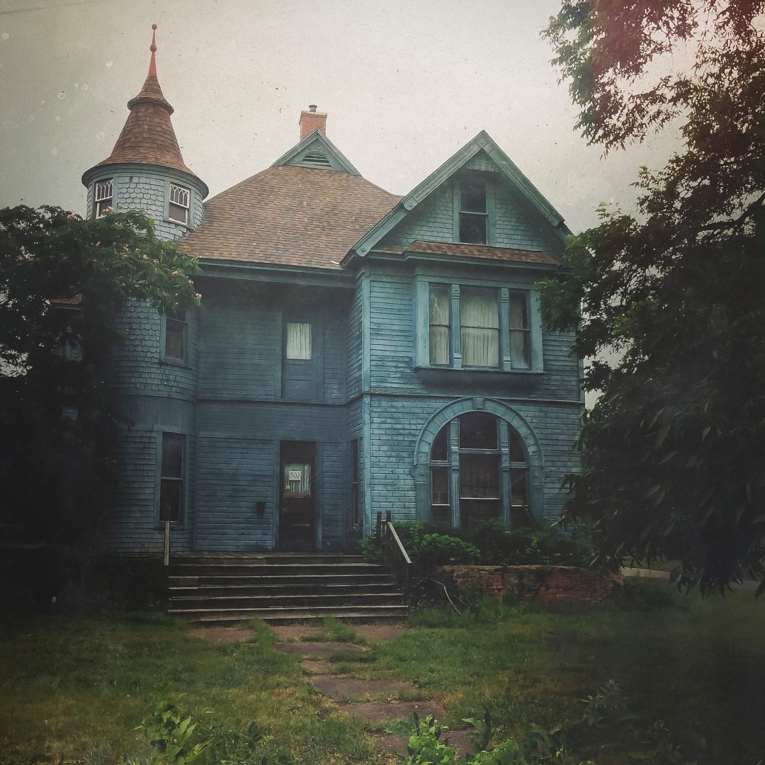 architectural photography of blue and brown house