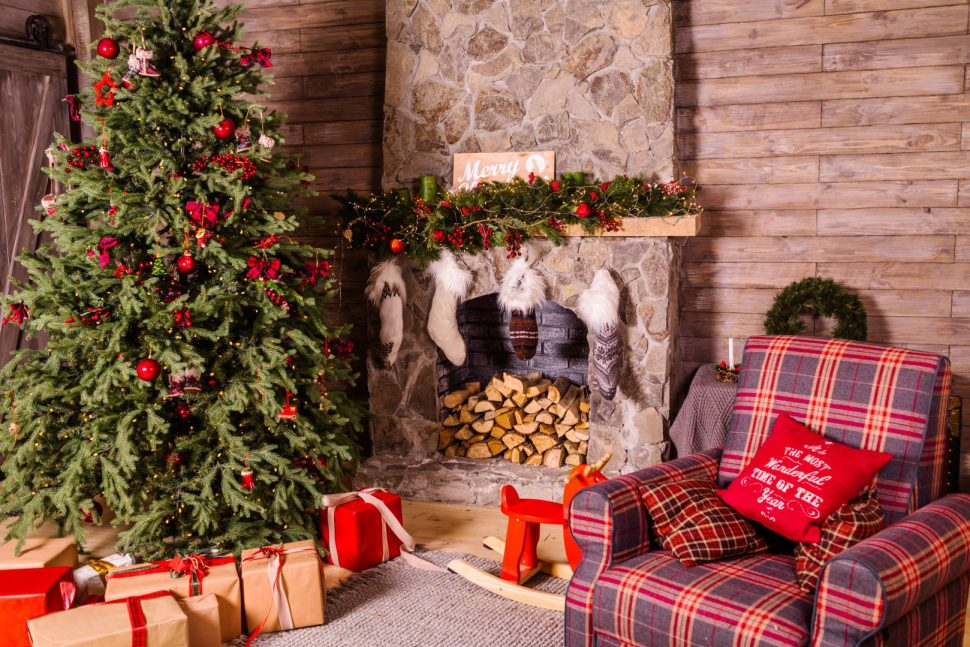 presents under Christmas tree near fireplace