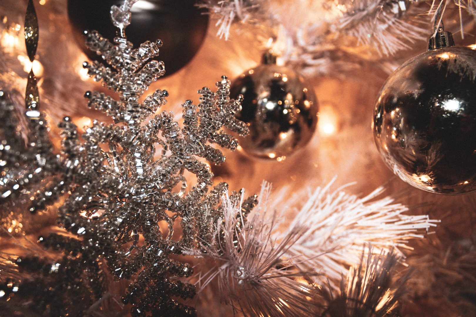 selective focus photography of gray Christmas bauble and snowflakes