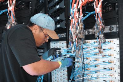 data center technician doing data center cabling