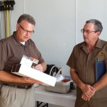Center Manager Todd Younkers presents certificates to Krout honoring his years of service.