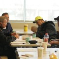 The Teamsters Local 710 Bargaining Committee answers questions about the new contract while members vote.