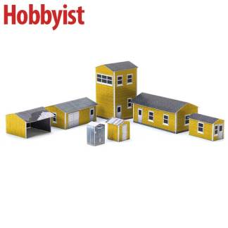 Yard buildings in yellow lapboard paper model kit
