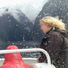 Milford-Sound-Small-Boat-Crew-Listening-To-Passenger-With-Empathy