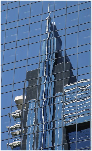 Office building reflection of Canadian high rise living