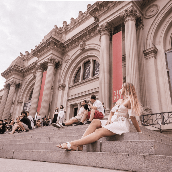 girl sitting on the steps of the Met in NYC
