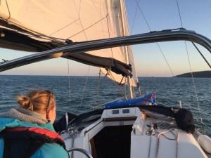 Woman helming sailing boat