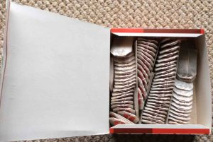 Picture of an open box of Salada Pekoe Cut Black Tea, showing the teabags, tags, and strings.