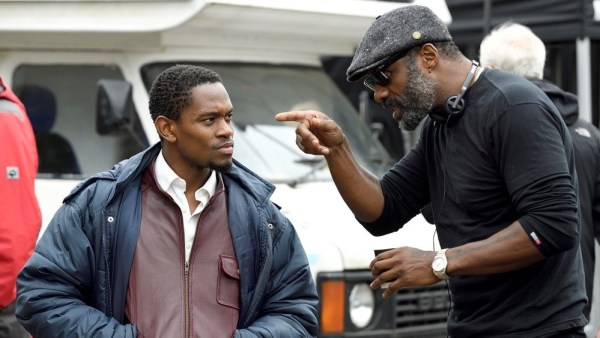 Aml Ameen and Idris Elba on the set of the movie Yardie