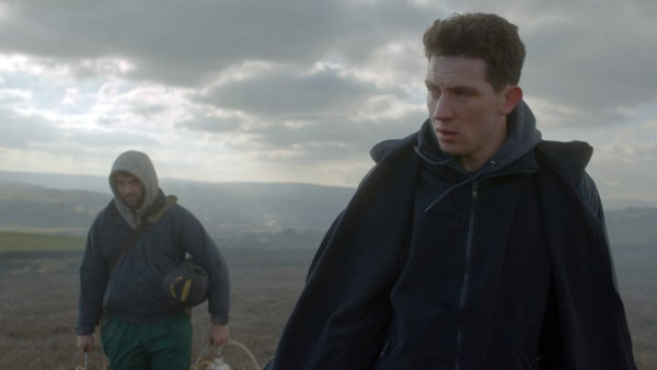 God's Own Country Movie - The film follows Johnny Saxby, a solitary young sheep farmer who numbs his daily frustrations with binge drinking and casual sex. The arrival of a Romanian migrant worker (Alec Secareanu) ignites an intense relationship that sets Johnny on a new path.
