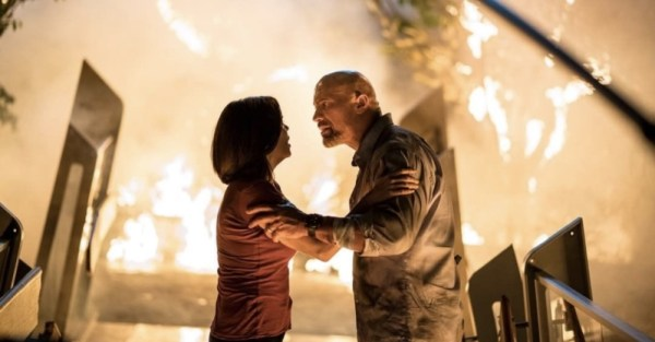 Neve Campbell and Dwayne Johnson in the movie Skyscraper (2018)