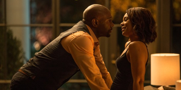 John Taylor (MORRIS CHESTNUT) with his wife Laura  (REGINA HALL) have a romantic moment while someone watches them from outside in the September 2016 movie WHEN THE BOUGH BREAKS.