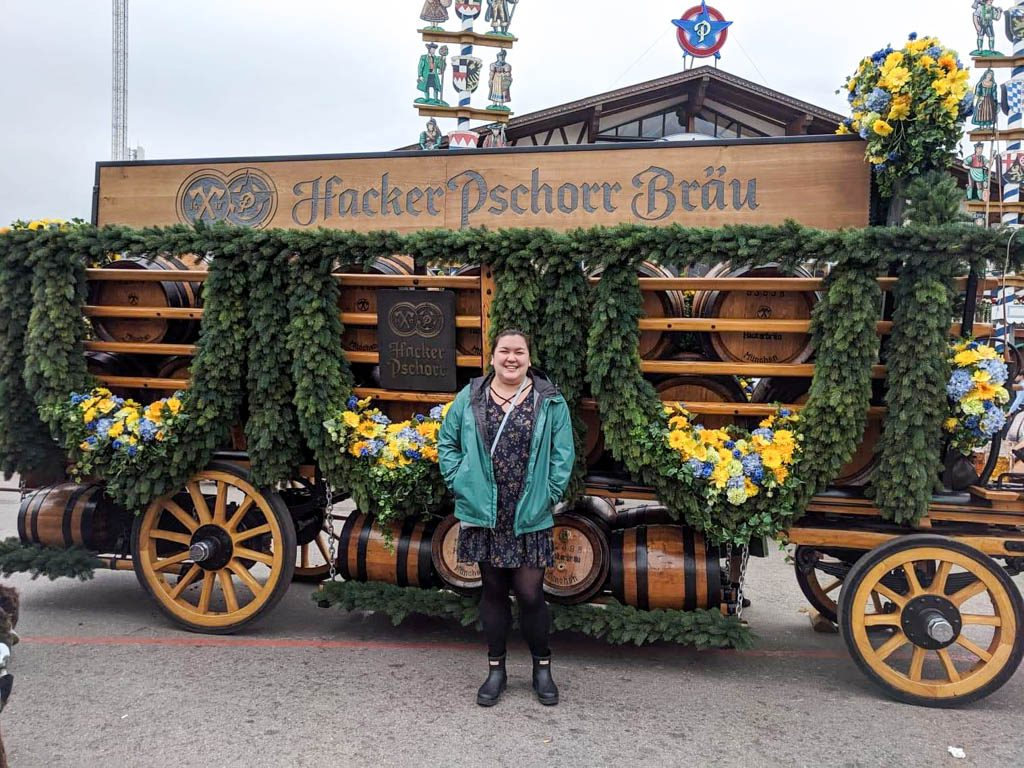 Riana posing in front of a beer cart at Oktoberfest