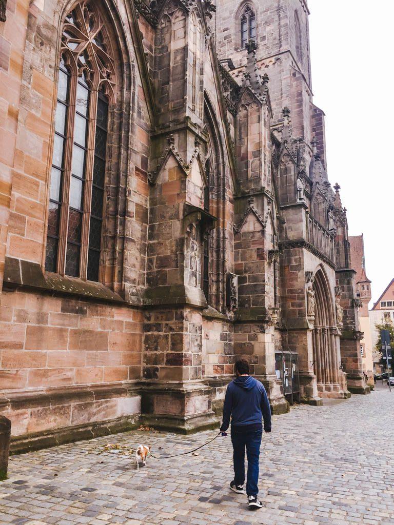 Colin and Ellie walking past St. Sebald or Sebalduskirche in Nuremberg