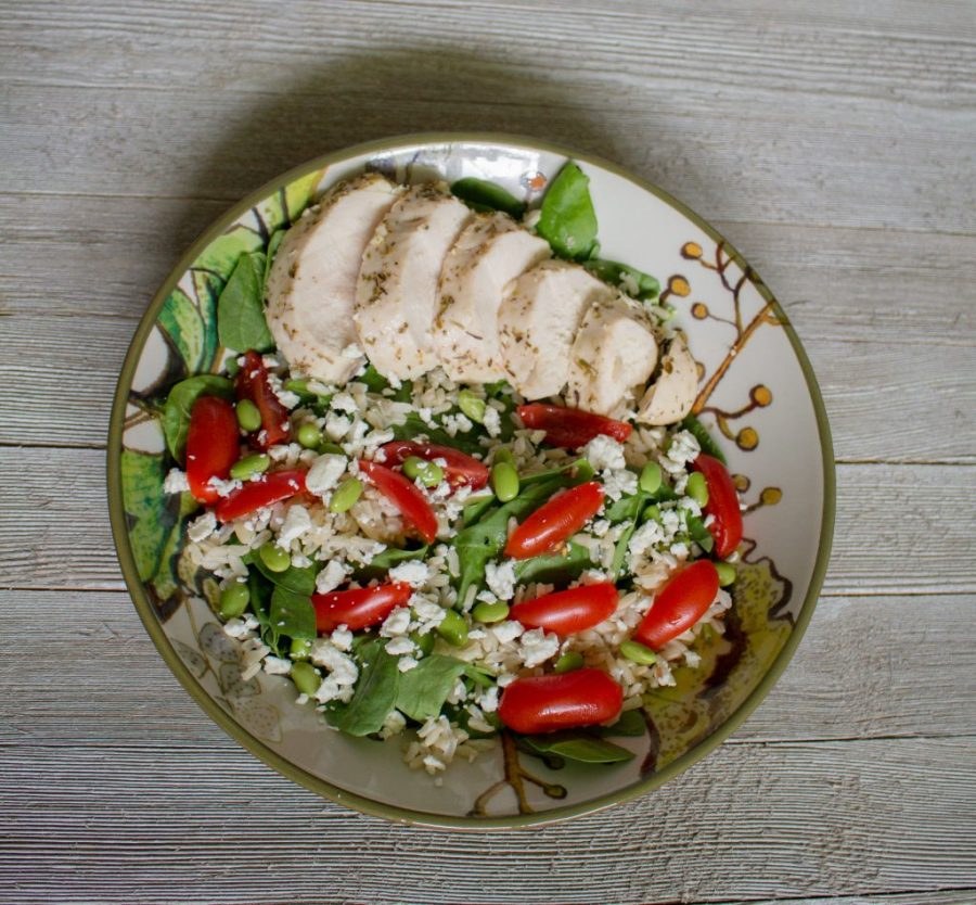 Greek chicken bowls make for a delicious & easy lunch. Whip up a batch on Sunday for lunch all week!