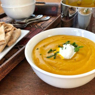 Roasted sweet potatoes, spices and coconut milk make a creamy velvety curry sweet potato soup. Recipe at Teaspoonofspice.com
