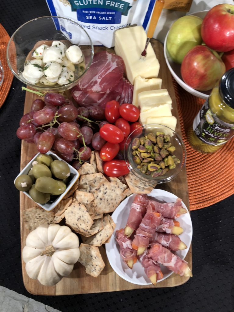 Add meats, cheeses, crackers, nuts, fruit and veggies to make a seasonal charcuterie board. #sponsored #aldi #halloween