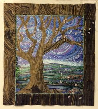 quilt with appliqued tree and apple blossoms by Beth