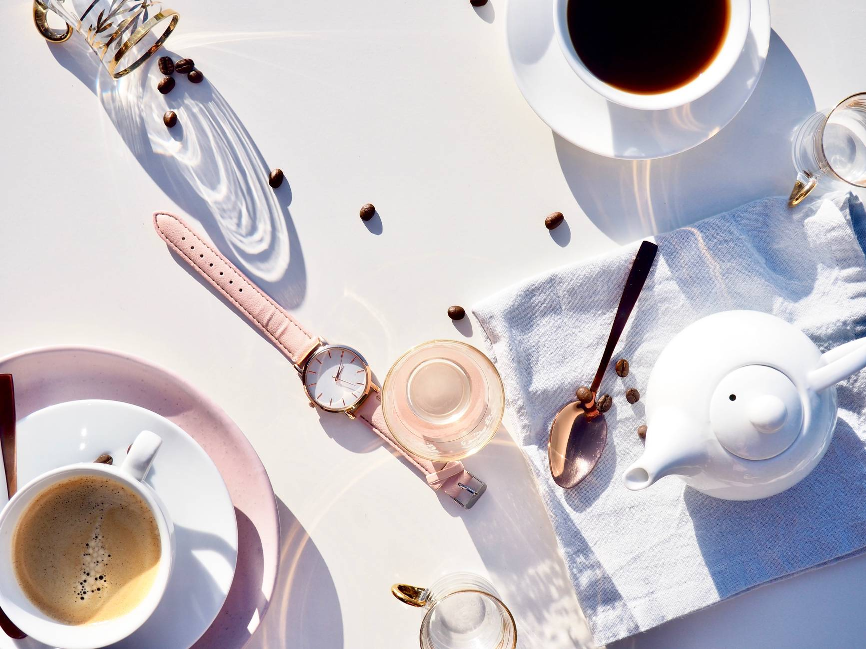 spoon watch cups and kettle on table