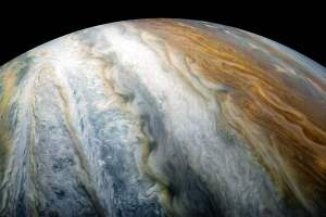 NASA image of the day shows Jupiter's colorful swirling cloud belts shot by Juno