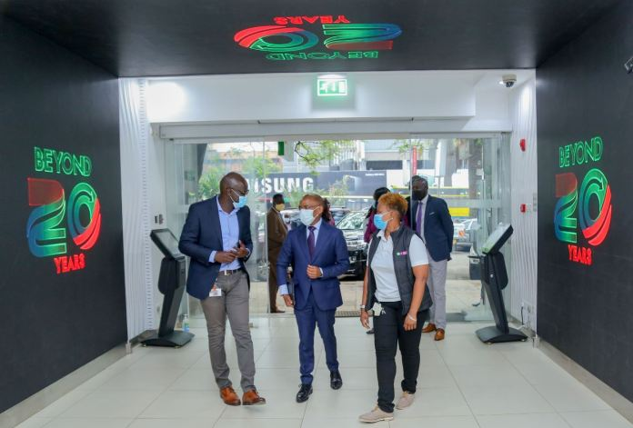 Safaricom HOD Retail Strategy, Franchise and Mobile Care Yudah Yogo, Safaricom Chief Executive Officer Peter Ndegwa, being taken around the newly refurbished shop with Sarah Indetie-Senior Manager Retail Asset Management during the launch of the heavy tech store in Moi avenue. This first-of-a-kind digitized flagship shop has a video tunnel at the entrance, digital interactive screens and device display screens for a wide variety of phones and accessories on sale.