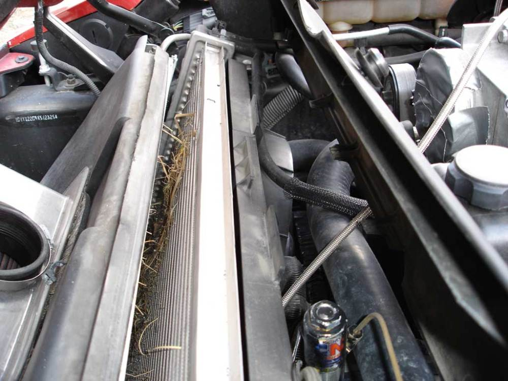 medium resolution of removing the radiator cover is simple and allows better access to radiator and a c condenser cover is affixed with two 10 millimeter hex head bolts on each