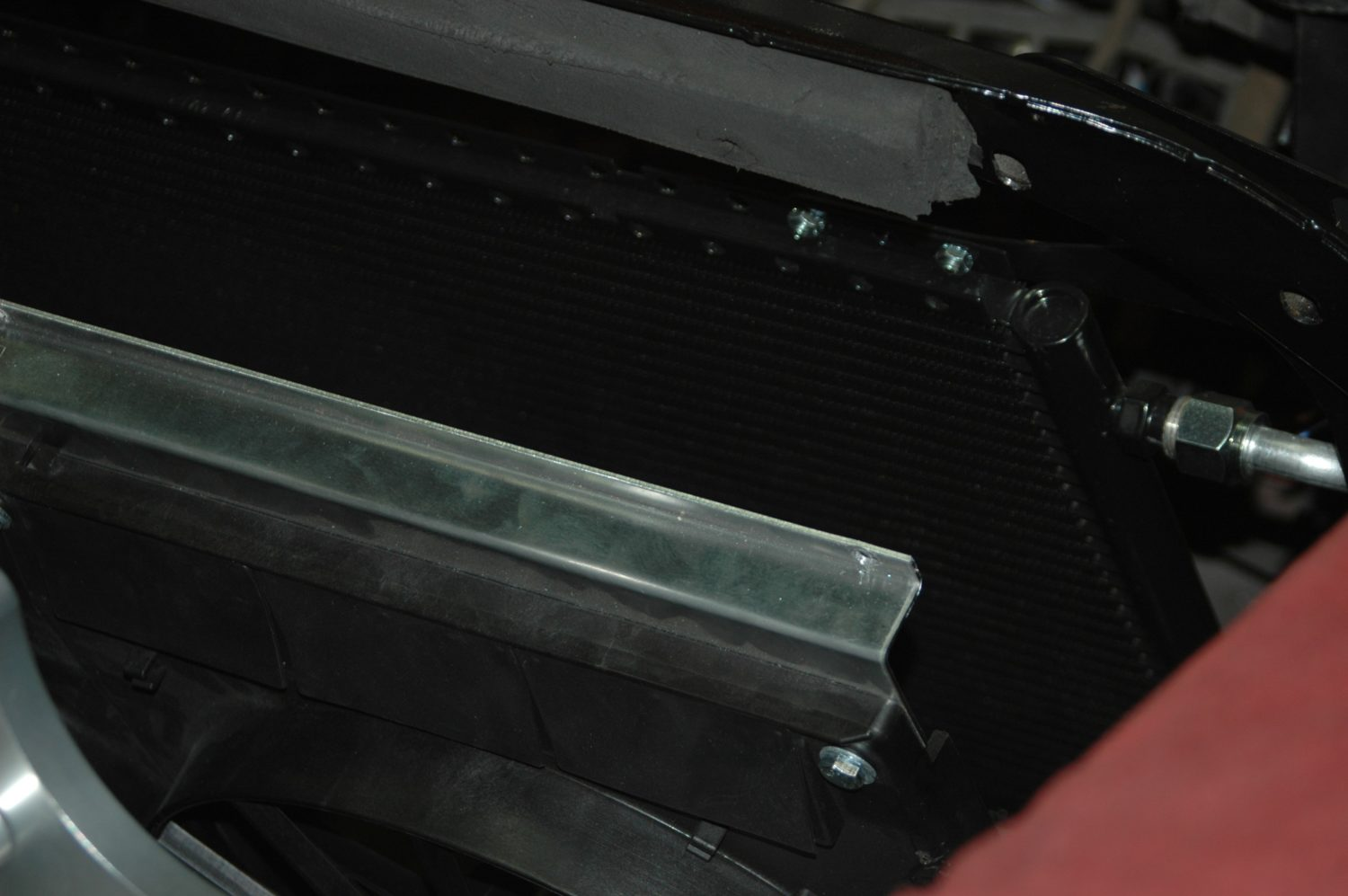 hight resolution of due to the space constraints of putting in the radiator with the engine already in place we have to remove the fans from the radiator and lay them loosely